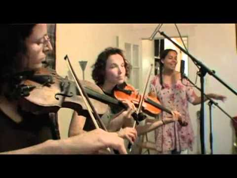 Knockin' performed by Carolina Chocolate Drops & The Luminescent Orchestrii