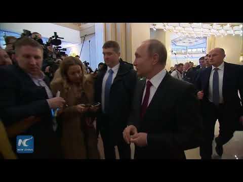 Vladimir Putin casts his ballot in presidential election