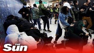 Hong Kong police arrest a dozen protesters using pepper spray and batons in 'shopping protest'