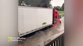 Driver Takes A HUGE Risk As They Plunge Truck Into Flooded Street