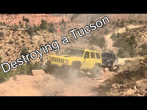 Towing service rescues a 2wd rental Hyundai Tucson stuck on a jeep trail