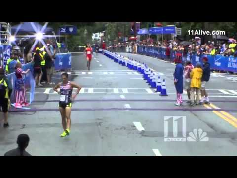Moment marathon runner gets beat after celebrating  Too Early
