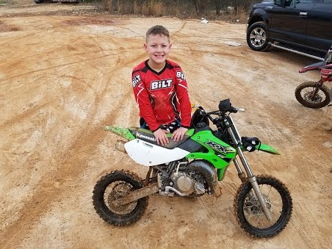 Nathan takes his 2017 Kawasaki KX65 trail riding…how will he do!?