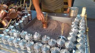 The real Turkish coffee cooked in the hot sand.