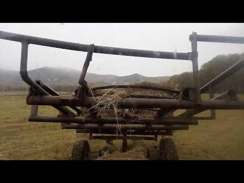 Самодельная телега для перевозки рулонов сена
