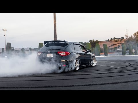BURNING TIRES IN A REAR WHEEL DRIVE SUBARU WRX!