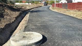 Continua lucrarile de asfaltare in Cartierul Domnitorilor din Lumina
