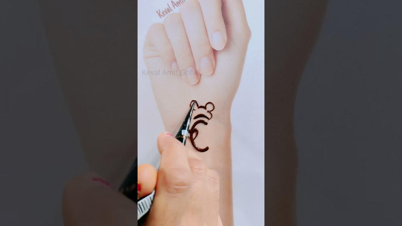 alphabet mehndi tattoo design by kevai amit gohel