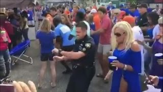 Watch This Police Officer Join Football Fans Dancing To Cupid Shuffle