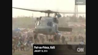 preview picture of video 'Haiti - Chaotic scenes as chopper drops aid'