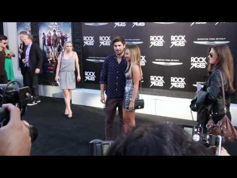 Ashley Tisdale and Zac Efron walk the red carpet at