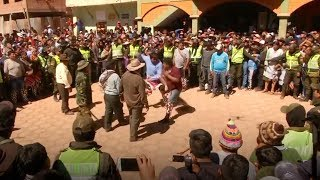 Fists fly at Bolivian fighting festival