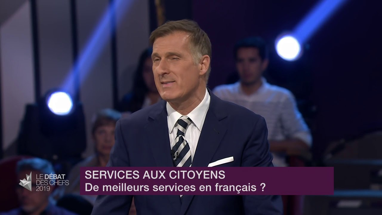 Maxime Bernier answers a question about services in French