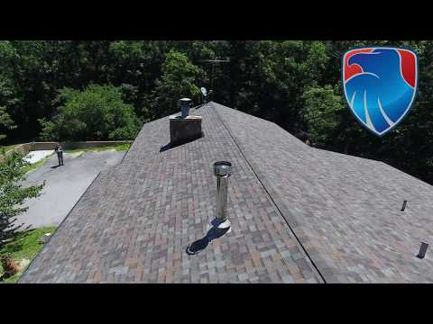 Our crew installed a new roof in Warrenton MO. The insurance company paid for the roof due to storm damage. The new Owens Corning Duration Aged Copper roof looks good.