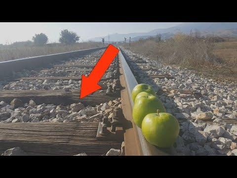 EXPERIMENT TRAIN VS APPLES Loram rail grinder under train view