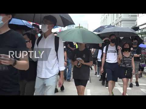 Hong Kong: Masked protesters march in defiance of ban