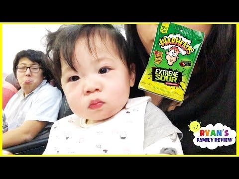 Twin Babies first airplane ride and Kid Warheads Sour Candy Challenge