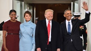 Trump arrives at White House, met by Obamas