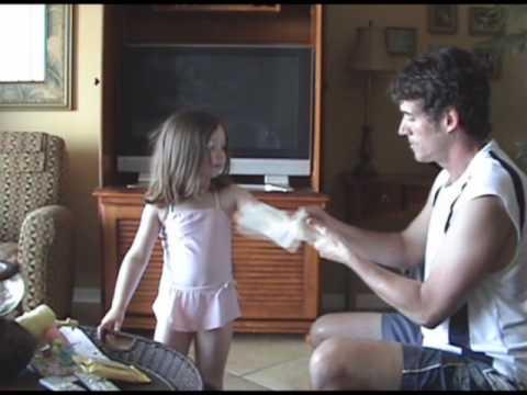 Shady Day Sunscreen wipes make little beach girl happy.