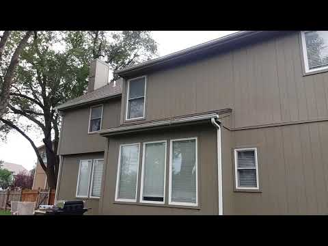 Olathe, KS home with new gutters, downspouts and kick out flashing at the corners.