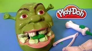 This is Play-Doh Shrek 2 Rotten Root Canal playset Dreamworks Hasbro toys, but compared to Dentist Playdoh Dr. Drill & Fill it has no electric drill tool. Since you're gonna be Shrek's new dentist, you can brush his teeth with this play set. Just Squeeze out bug toothpaste to clean his teeth, or fill his cavities. Mix together compound colors to create rotten teeth. Extrude his tongue, and mold 2 different kinds of ogre teeth. Includes 3 cans, dentist tools and a head. Now get out of my Swamp, LOL  Music from Kevin Macleod.  Here's how dough is also called plastilina, pasta de modelar, Arcilla, juegos de moldear, juegos de modelar,  Softee-Dough, Moon-Dough, Clay, Plasticine, Pâte à modeler, Modelliermasse, Plastilin, Plastiline, Plasticina, пластилин, лепка из глины, Crayola, Muovailuvaha, 플레이도, Ciastolina, เพลย์โดว์, 培樂多.