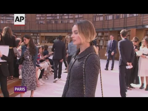 Chanel continues without Karl Lagerfeld as Virginie Viard shows her first couture collection for the fashion house in Paris, with Margot Robbie front row. (July 2)