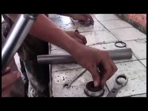 como  comprimir un resorte de amortiguador  y recargar un amortiguador
