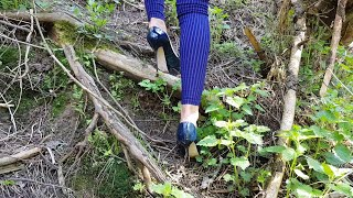 the girl climb on high heels, walk uphill and downhill on high heels, heels in the forest (scene 29)