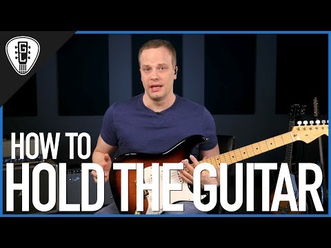 How To Hold The Guitar - Free Guitar Lesson