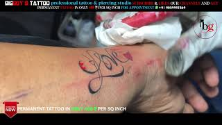 Permanent Colourful Love Tattoo On Female Wrist By Bigguy's Tattoo And Piercings Studio 9029993269.