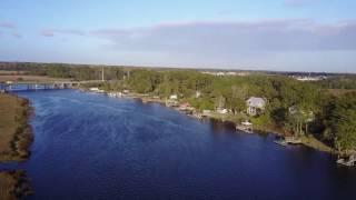 Flying a mavic drone around rich riverside property