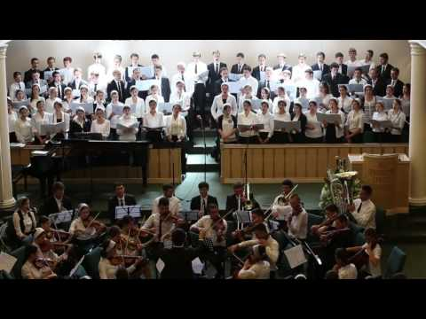 Joseph conducts an original composition for choir and orchestra in California.