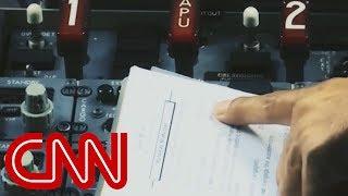 Report: Pilots scoured manuals in doomed flight