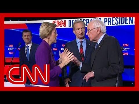 Watch tense exchange between Warren and Sanders after debate