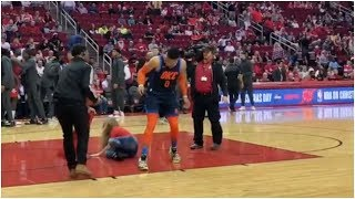 Russell Westbrook knocks over the National Anthem singer in Houston 😂