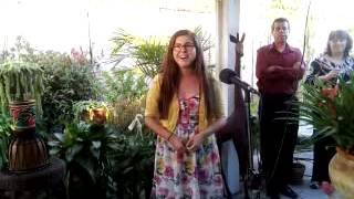 Sarah De Herrera singing the National Anthem in Choctaw
