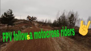 FPV drone follow a motocross riders