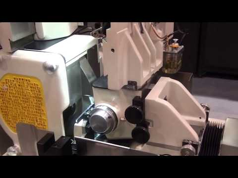 TG-12x4 Servo Cycle Centerless grinder making a coronary guidewire with a diameter of .002""