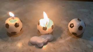 Candle in the shape of a soccer ball サッカーボールの形をしたキャンドルに火をつける。