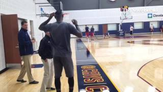LeBron James talking team defense principles with Akron coach Keith Dambrot.