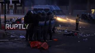 Italy: Police unleash water cannons on rioting migrants in Rome