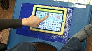 Elementary student uses LAMP Words for LIfe app on iPad with his toe