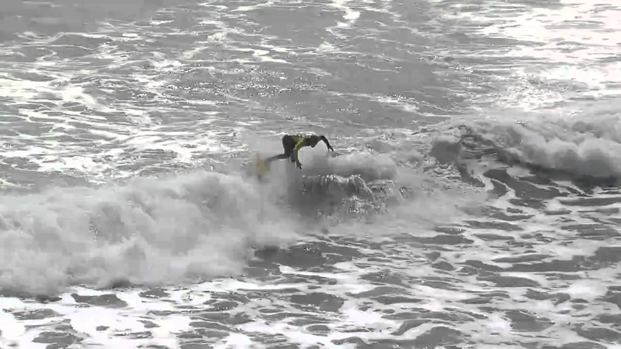 Watch The First Surfboard Kick Flip Ever Caught On Film