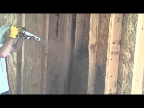 Installing Cellulose Wall Spray.  Cellulose is added with water to form a solid block of cellulose within the...