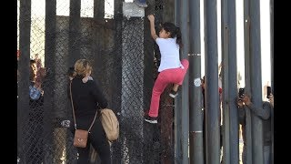 CAUGHT ON CAMERA: MIGRANTS FROM CARAVAN CROSS OVER ILLEGALLY. DETAINED BY BORDER PATROL