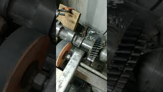 Repairing a damaged camshaft lobe with a welder and old atlas lathe