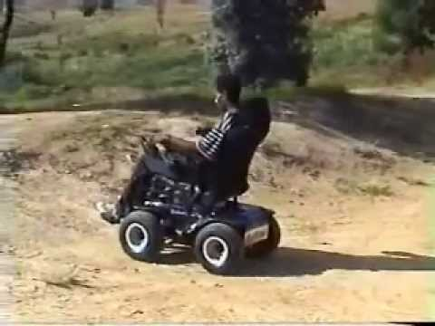 Predator 4 x 4 Driving up a steep dirt hill