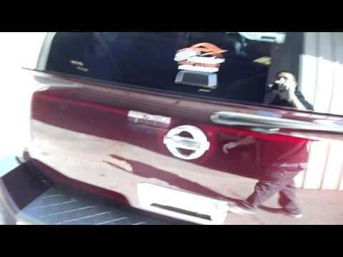 NISSAN ARMADA CANDY BURGUNDY BAGGED ON 28 INCH WHEELS FROM PREMIER PAINT & BODY