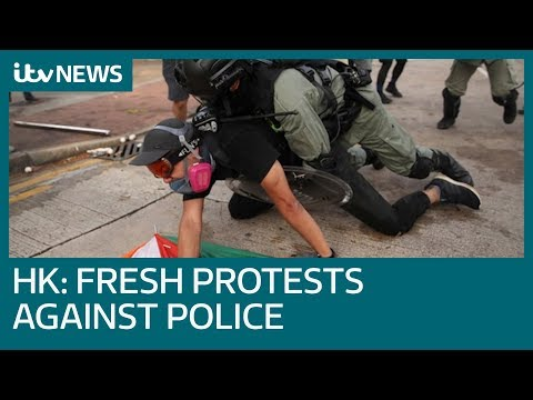 Protesters battle police on multiple fronts in Hong Kong | ITV News