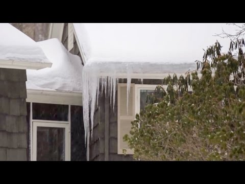 "In Episode 72 of the ""On the Job"" video series, Larry Janesky, owner and founder of Dr. Energy Saver, speaks about a problem that is common during cold winters: ice damming on the roof. While ice dams don't happen very often, when icicles do appear on the edge of the roof, the consequences can be disastrous. Ice dams occur after snow storms when heated roof shingles cause the snow to melt and the outside temperatures are cold enough to freeze dripping water at the edge of the roof, forming an ice barrier.When that happens, the water from the melting snow gets trapped behind the icy wall and usually finds its way into the house, through the gaps between the shingles. The water not only can damage the roof itself, but it can also leak into the attic and into wall cavities, causing extensive damage to the home. What causes ice damming and what are the ways to prevent it? Larry explains that, while not all ice damming can be prevented, in many instances, the ice dams are a tell-tale sign of a poorly insulated and air sealed home – especially in the attic area. It means that heated air is escaping from your living space into the attic and heating the roof. Most attics in U.S. homes are unconditioned, meaning, the attic is not part of the heated, conditioned living space. The air that you pay to heat should not be escaping to the attic. By properly air sealing all the gaps that allow air to leak out, and by bringing attic insulation R-Value up to 60, as recommended by the U.S. Department of Energy for homes in the cold regions of the U.S, you will keep the heat where it belongs: inside your living space. The temperatures in the attic will be similar to the outside temperatures and the shingles are less likely to be heated and cause snow melt. While making your home more comfortable and energy efficient, in many cases, this will also help alleviate ice damming problems and protect your property from damages caused by ice dams. Please note that ice damming can occur due to other circumstances such as sun heat on the shingles. Monitoring your roof after snow storms, removing some of the snow from the roof, and other preventive measures might still be necessary even if your attic is properly air sealed and insulated."